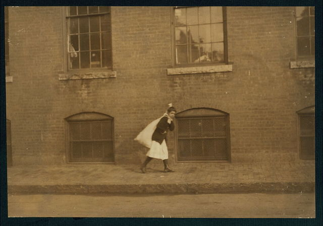 5 minutes to 9 A.M. Eleven-year-old girl running home with a twenty-pound load of garter buttons for home-work. Trying not to be late for school. (See also Report.)  Location: Worcester, Massachusetts.
