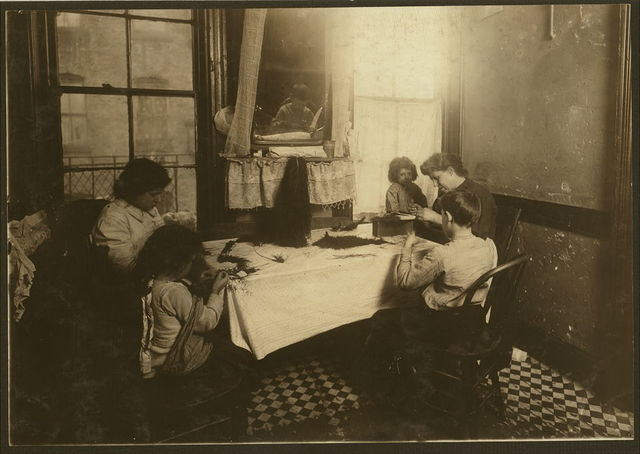 """5 P.M. Mrs. Mary Molinari and family, 304 E. 107th St. """"We made feathers some, but not much."""" Six-year-old Antoinette ties like an old hand. Dominick, 9 years old, works some. Annie 9, the oldest girl, works in a shirt-waist factory. Father is a hod carrier.  Location: New York, New York (State)"""