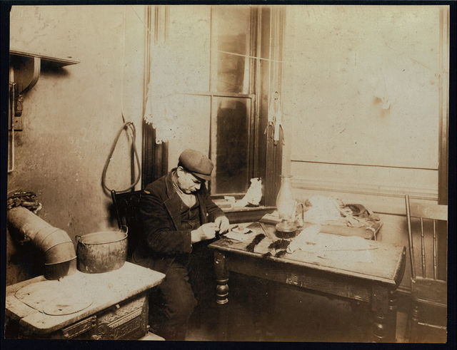 6 P.M. Francesco Forzaro, 313 E. 107th St., N.Y. Fifty-five year old man adding a little to income by making feathers. Can make about one dollar a week. Works by dim lamp-light in dark rooms. Is cheerful too. His 17 year old son helped him at this, but has just gone to work as an apprentice to plasterer.  Location: New York, New York (State)