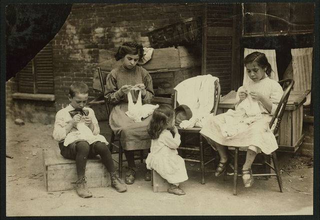 A 9 year old boy, Jo Cafarella, 39 Warren Street, Somerville, Mass. His sister Lena, 10 years, and Mary Lazzaro, 13 years old, his cousin lives at 17 South Street. This is typical of their work. Very few boys work on crochet, but he has for 2 years.  Location: Somerville, Massachusetts.