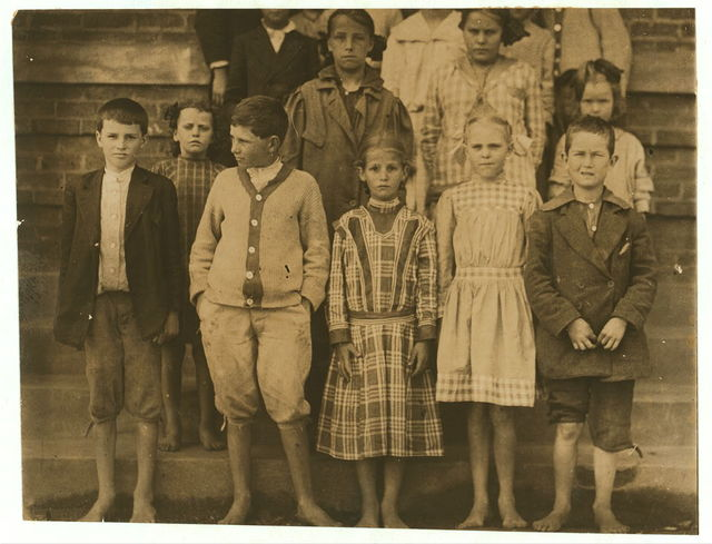 """A group of school children in the third and fourth grades of the Cowpens, S.C., School. All in the front row are 9 and 10 years old (compare these with the little children shown in #2970-75.) The principal said only one out of 10 in the school were mill children (and he was not apparently very anxious that they should be) """"The mill is only a small part of the village.""""  Location: Cowpens, South Carolina."""