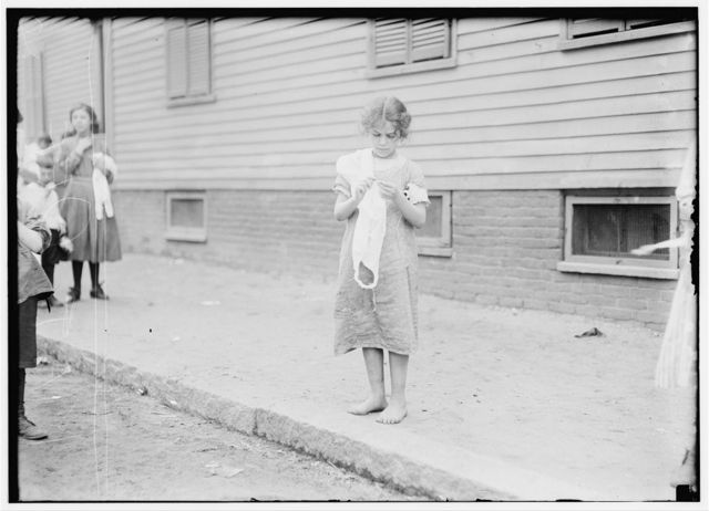 A typical view of Carmina Caruso, a ten year old Home Worker as she walks around crocheting as she goes. See also other photos of her and Home Work report.  Location: Somerville, Massachusetts.