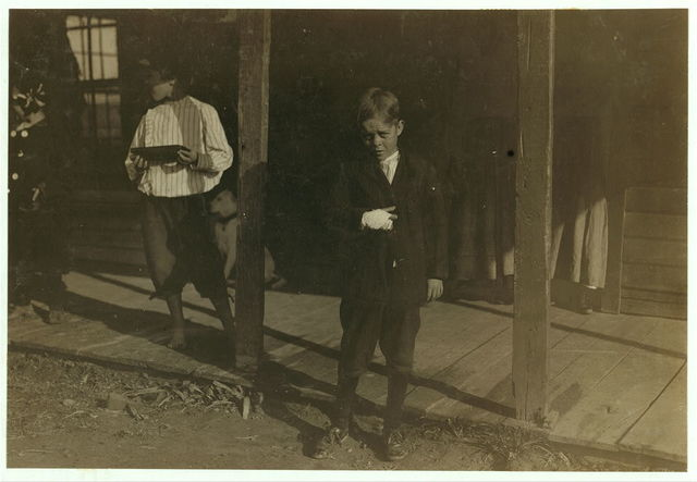 """[Accident to young cotton mill worker. Giles Edmund Newsom (Photo October 23rd, 1912), while working in Sanders Spinning Mill, Bessemer City, N.C., August 21st, 1912, a piece of the machine fell on to his foot mashing his toe. This caused him to fall on to a spinning machine and his hand went into unprotected gearing, crushing and tearing out two fingers. He told the Attorney he was 11 years old when it happened. His parents are now trying to make him 13 years old. The school census taken at the time of the accident makes him12 years (parents' statement) and school records say the same. His school teacher thinks that he is 12. His brother (photo 3071) is not yet 11 years old. Both of the boys worked in the mill several months before the accident. His father, (R.L. Newsom) tried to compromise with the Company when he found the boy would receive money and not the parents. The mother tried to blame the boys for getting jobs on their own hook, but she let them work several months. The aunt said """"Now he's jes got to where he could be of some help to his ma an' then this happens and he can't never work no more like he oughter.""""].  Location: [Bessemer, North Carolina]."""