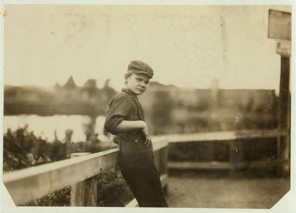 Adolescent boy (illiterate) working in cotton mill Easthampton, Mass. Compare him with photo #3033.  Location: Easthampton, Massachusetts.