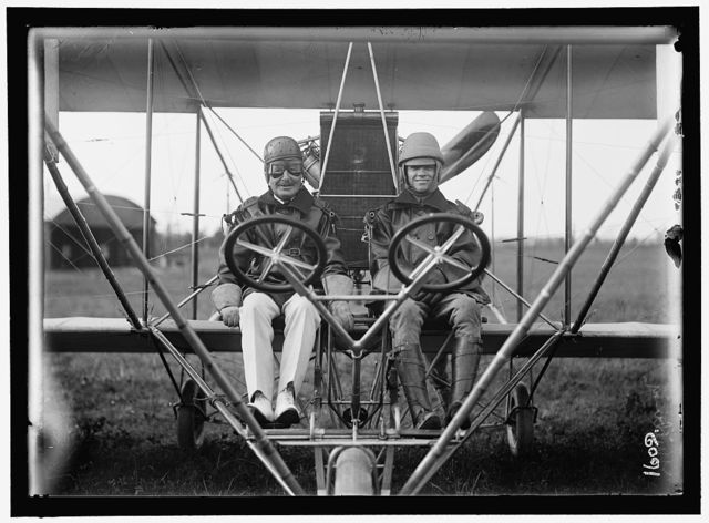 AVIATION, NAVY. COMMODORE J. C. GILLMORE IN CURTISS HEADLESS PLANE, DUAL CONTROL, AT COLLEGE PARK ARMY FLYING FIELD, LT. MILLING, RIGHT