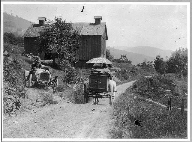 [Buick roadster waits for horse-drawn wagon to pass on narrow country road above Liberty, N.Y.]