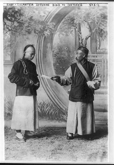 [China - colporteur offering bible to Cantonese]