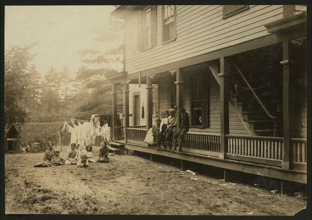 Cottage Street hovels down by the river in Easthampton, Mass., in which a great deal of home work is done on suspenders.  Location: Easthampton, Massachusetts.