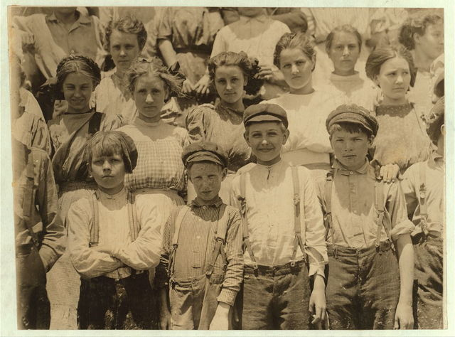 Detail of faces of younger workers in Aragon Mill, Rock Hill. Several smaller did not get into the photograph.  Location: Rock Hill, South Carolina.