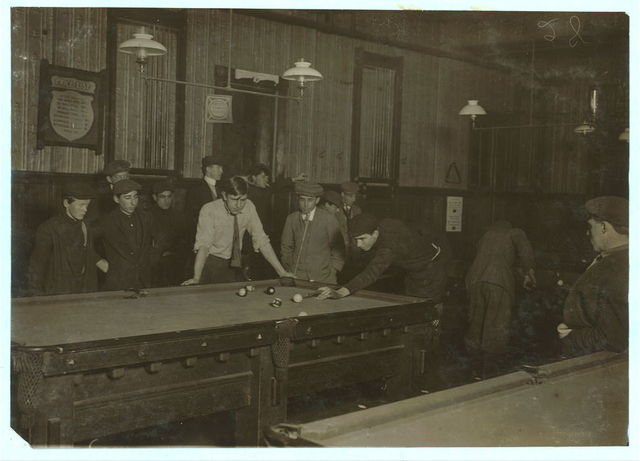 Elm Pool Room (inside): Nathan Sher, 69 Walden St. William Donovan, Elm Pool Room. George, 28 Elm St. (youngest pin boy). Bill Simmons (manager). Frank Worcester, 28 Elm St. Alton Tripp, 31 High St. Theodore Lewis, Elm Pool Room. Donnie Murray, Elm Pool Room. Joe Correia, 36 Elm St.  Location: New Bedford, Massachusetts.