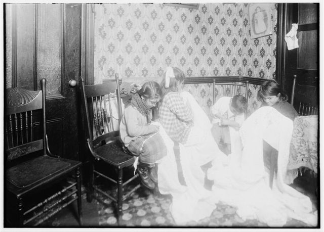 [Embroidering chiffon waists in crowded bed-room, East Side. (For complete details Miss E. C. Watson's report.)].  Location: New York, New York (State)