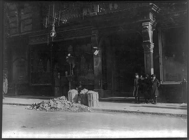 Entrance to licensed tenements, 170-172 Thompson Street, N.Y., where home-work flourishes.  Location: New York, New York (State)
