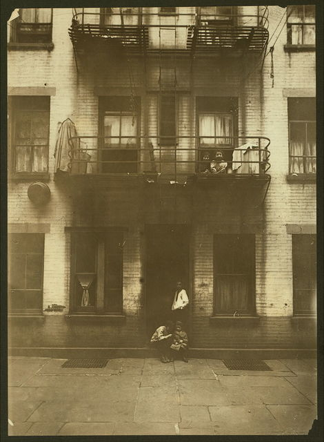 Exterior of rear tenement in which home-work is going on. (For complete details see Miss E.C. Watson's report.)  Location: New York, New York (State)