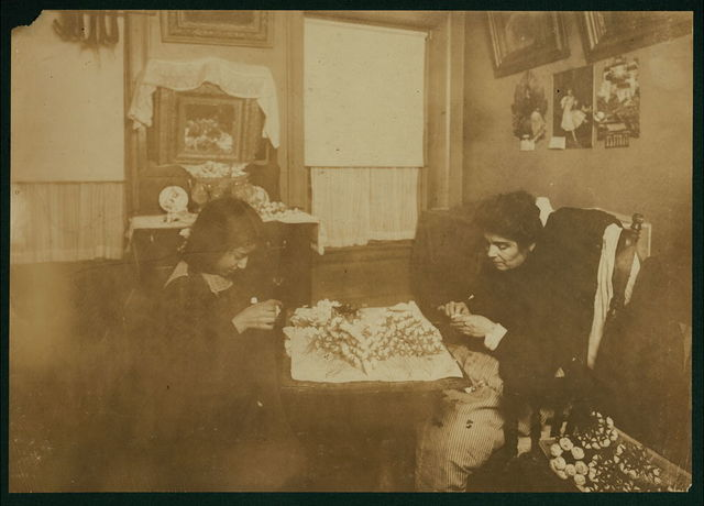 Flower making. A night scene (Photo at 10:30 P.M. and not finished, Jan 29, 1912). Carrie Brindisi,12 years old, 134 1/2 Thompson Street, 2[nd] fl[oor] front. Carries [sic] goes to school. Works after school and nights, Rosie (six years old) helps too.  Location: New York, New York (State)