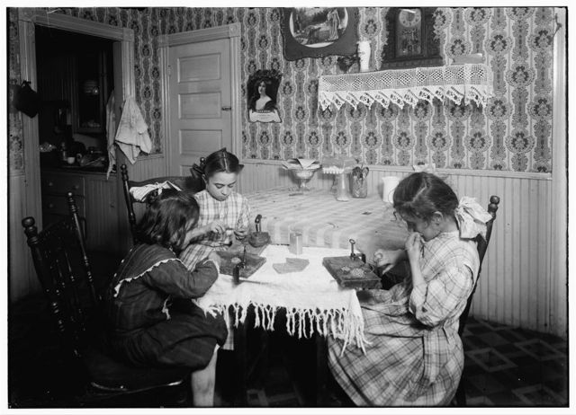 (For Child Welfare Exhibit 1912-12.) Girls, six, nine, and eleven years old, working on chain-bags, Mrs. Antonio Caruso, 132 Knight St., Providence, R.I.  Location: Providence, Rhode Island.