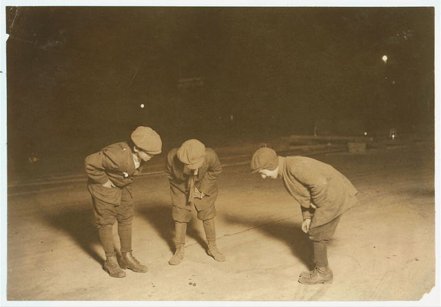 (For Child Welfare Exhibit 1912-13.) A midnight crap game in the street near Post Office, Providence, R.I. Nov 23, 1912. One 12 years old, one 14. One had been shooting here a couple of hours.  Location: Providence, Rhode Island.