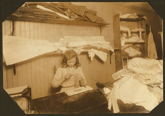 (For Child Welfare Exhibit 1912-13.) Elvira Christofano, 110 Spruce [?] St., Providence, making chain-bags.  Location: Providence, Rhode Island.