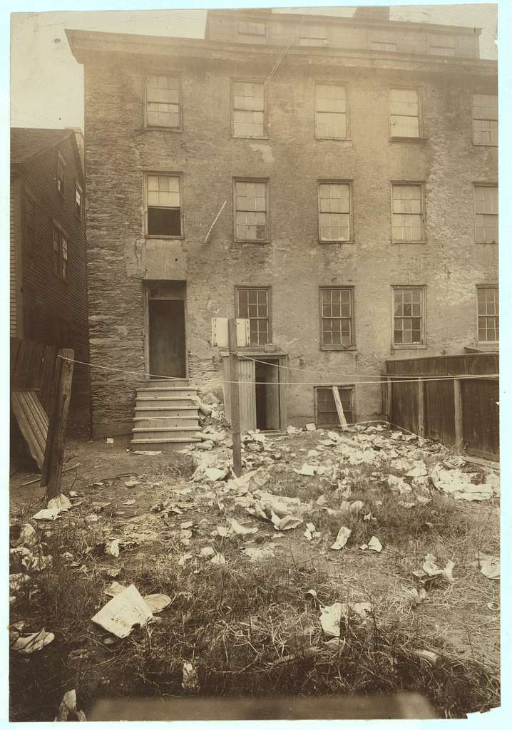 (For Child Welfare Exhibit 1912-13.) Rear of a six-family house, 230 Richmond Street, Providence. Location: Providence, Rhode Island