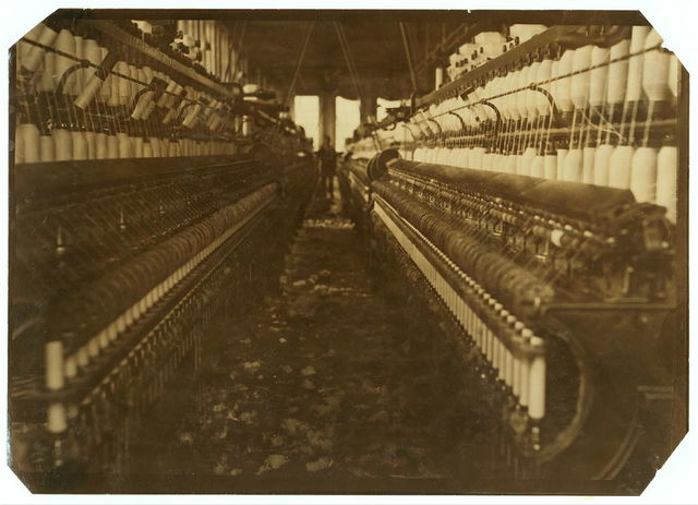 (For Child Welfare Exhibit 1912-13.) View in a Pawtucket, R.I., cotton mill showing accumulation of lint on floor. The air is full of it too, but photo doesn't show it.  Location: Pawtucket, Rhode Island.