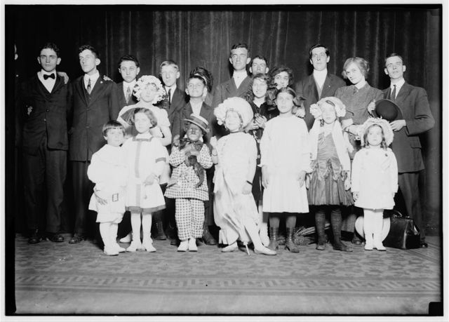 Group of children acting in the Majestic Theatre on Amateur Night. The children are (alleged) amateurs, the older ones are mostly amateurs, with a few professionals. (for further details see report of L.W. Hine, April 1912). Following are names of youngest: Little Audrey Shrier (8 yrs. old), Arthur Goldbert (4 yrs. old), Frank Goldberg (6 yrs. old), Jeannette Goldberg (10 yrs.old), 463 Pennsylvania Ave, N.W., Washington D.C., Marion Skinner (4yrs. old), Gertrude Skinner (12 yrs. old), 910 Pennsylvania Ave., S.E., Washington D.C. Ann Suter (7 yrs.), 27 H St., N.W. Grace George (9 yrs. old), 425--7th, S.W. Rose Friedberg (12 yrs. old), 129 Heckman St., S[?] W. Devid Zeregen (13 years old), 1215 E St., N.W. Portland Ratcliffe, (15 yrs. old), 66 I St., N.W.  Location: Washington (D.C.), District of Columbia.