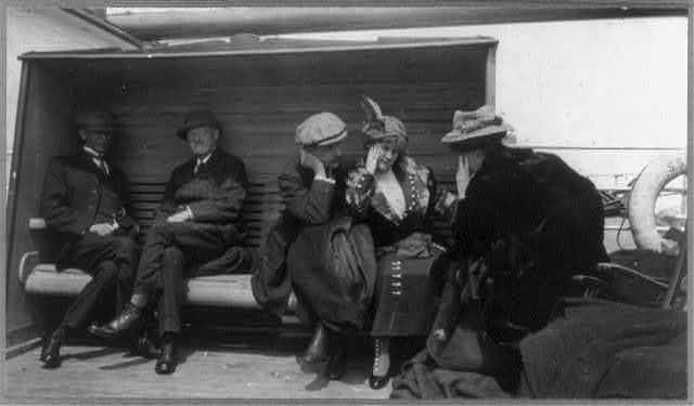 [Groups of TITANIC survivors aboard rescue ship CARPATHIA: Mr. & Mrs. G.A. Harder and Mrs. Charles M. Hayes talking]