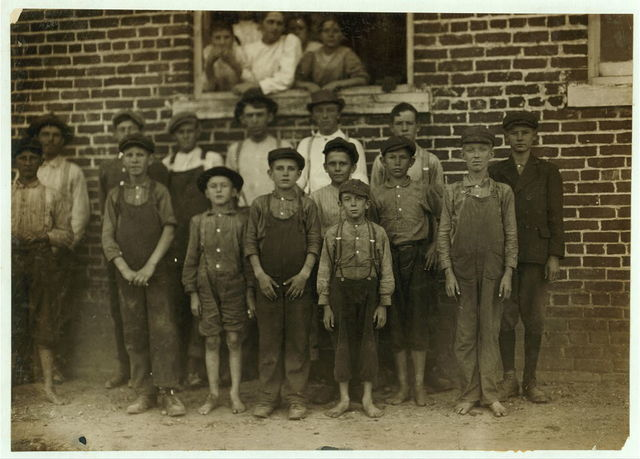 Groups of workers in Clayton (N.C.) Cotton Mills. Every one went in to work when the whistle blew, and I saw most of them at work during the morning when I went through. Mr. W.H. Swift talked with a boy recently who said he was ten years old and works in the Clayton Cotton Mill, also that others the same age worked. Here they are. I couldn't get the youngest girls in the photos. Clayton is but a short ride from the State Capitol. (The Superintendent watched the photographing without comment.)  Location: Clayton, North Carolina.