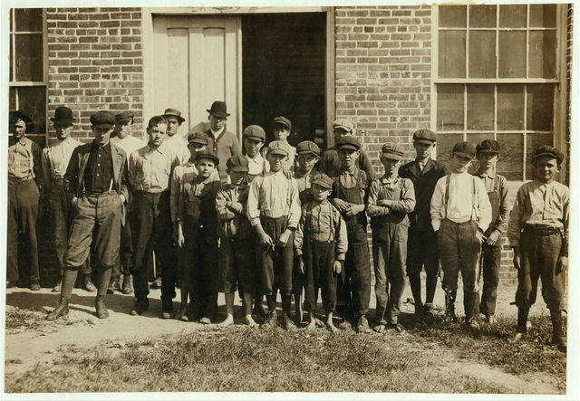 Groups of workers in Clayton (N.C.) Cotton Mills. Every one went into work when the whistle blew, and I saw most of them at work during the morning when I went through. Mr. W.H. Swift talked with a boy recently who said he was ten years old and works in the Clayton Cotton Mill--also that others the same age worked. Here they are. I couldn't get the youngest girls in the photos. Clayton is but a short ride from the state Capitol. (The Superintendent watched the photographing without comment.)  Location: Clayton, North Carolina.