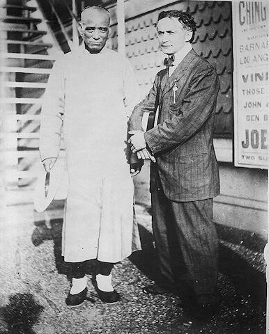 [Harry Houdini and Chinese magician Ching Ling Foo, full-length portrait, standing, Brighton Beach, New York]