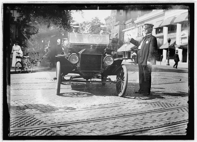 Herbert E. French in Ford stopped by traffic cop