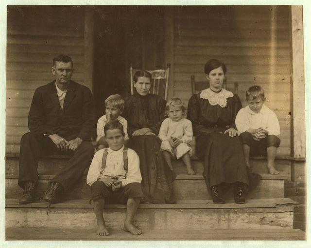 Johnie William Bumgarden (boy in front and part of his family). His birth record in the family bible says born May 7th, 190[2?] Just past his 10th birthday, is learning to doff. Got a regular job. 35 cents a day. Been at it a few weeks. Cannot write very well. Says he is 12 years old. Father said 5 of the family formerly worked in the mill making $28 a week. They take boarders which bring them $5 a week. A total of $33 a week. (Later the father said the record in the bible was put in wrong.) Rock Hill. S.C.  Location: Rock Hill, South Carolina.