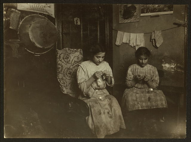 Katie (13 years) and Angeline Javella (11 years), 311 E. 149th St. 2[nd] floor front, making cuffs, Irish lace. Income about $1 a week. Said they work some nights until 8 P.M.  Location: New York, New York (State)