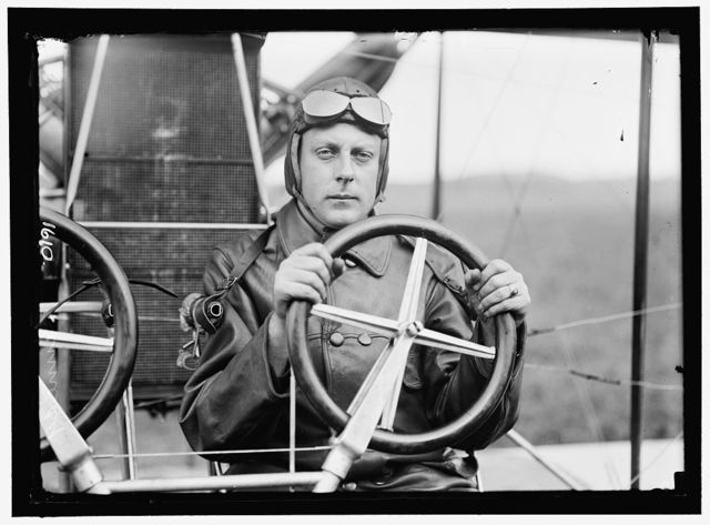 KENNEDY, FRANKLIN. LT., U.S.A. AVIATOR. IN CURTISS DUAL CONTROL AIRPLANE, HEADLESS; COLLEGE PARK, MARYLAND