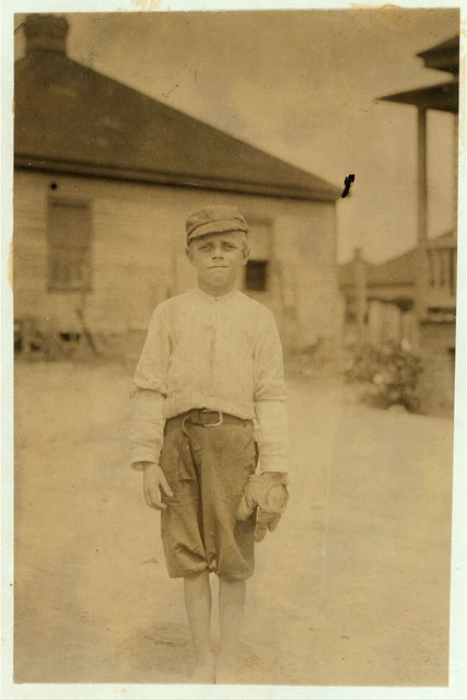 Lloyd McAbee been doffing several months in the Spartan Mill, Spartenberg [sic], S.C. His step brother Walter Brown been working for one year. The parents said they couldn't find the family record, that the boys were 12 and 13 years old. The father works the farm 3 miles away. Sister in the mill. Mother wouldn't be photographed. (See family group 2989.)  Location: Spartanburg, South Carolina.