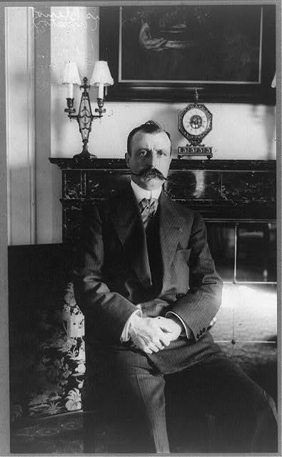 [Louis Blériot, three-quarter length portrait, seated, facing front]