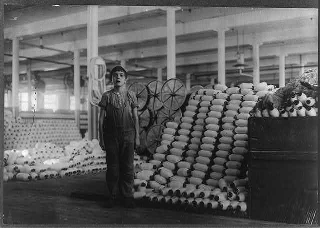 """Manuel Miranda, 229 Alden St. Very young boy, has been doffer in card room of Cornell Mill for 6 months. Said, """"I'm goin' on 16"""" (but didn't say when he would reach it). Cornell Mill.  Location: Fall River, Massachusetts."""