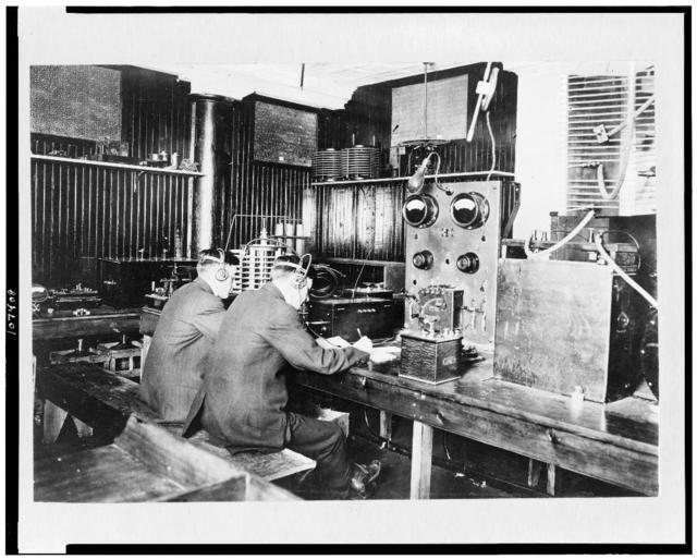 [Marconi wireless school, New York.  Operators copying messages transmitted from ships at sea]