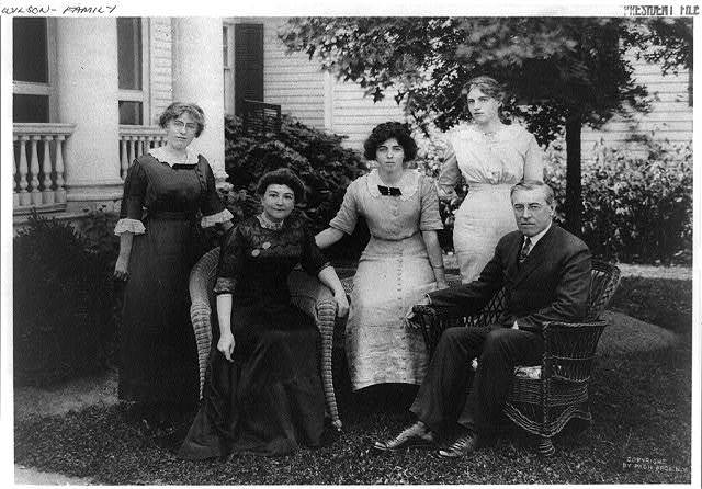 [Mr. and Mrs. Woodrow Wilson seated on lawn with their three daughters (left to right) Margaret, Eleanor, and Jessie, in Cornish, New Hampshire]