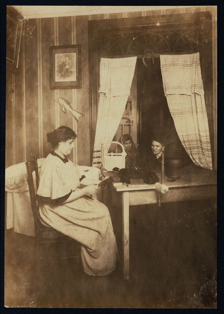 Mrs. Abrams, 15 E. 118th St., N.Y. (ground floor). Makes hair-puffs and switches in her parlor. Dresses hair also. The neighbors, in dark inner bed-room, converse as she works. Husband (photo on the wall) is a painter. Many so-called Hair Dressing Parlors, are of this type.  Location: New York, New York (State)