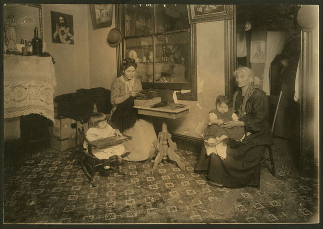 Mrs. Larocca, 233 E. 107th St., N.Y., making willow plumes in an unlicensed tenement. Photo taken Feb. 29, 1912. License was revoked Dec. 19, 1911.Applied for again Feb 7, 1912, inspected Feb. 13 and refused Feb 14, 1912. Feb. 29, 1912 I found nine families (including the janitress) at work on feathers or with traces of the day's work still on the floor. Still other families were reported to be doing the work also, but were not home. When our investigator made her first calls here, she found the whole tenement in much worse condition (see schedule) Children had bad skin trouble, fever, etc. Grandmother was working the day this photo was taken.  New York, New York (State)