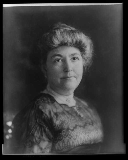 [Mrs. Woodrow Wilson (Ellen Axson), full-length portrait, seated, facing right, holding flowers]