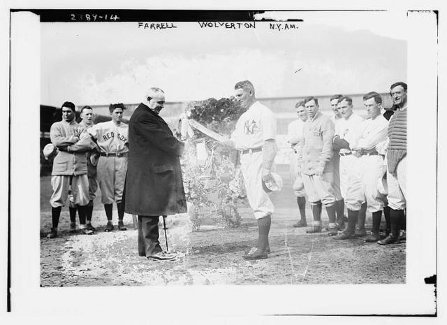 [New York Yankees president Frank Farrell presents loving cup to Yankees manager Harry Wolverton as Red Sox and Yankees players look on at Hilltop park, New York, April 11, 1912 (baseball)]