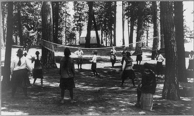 Payette Lake, Idaho. 1912-1920? Girls playing volley ball at a Young Women's Christian Association camp
