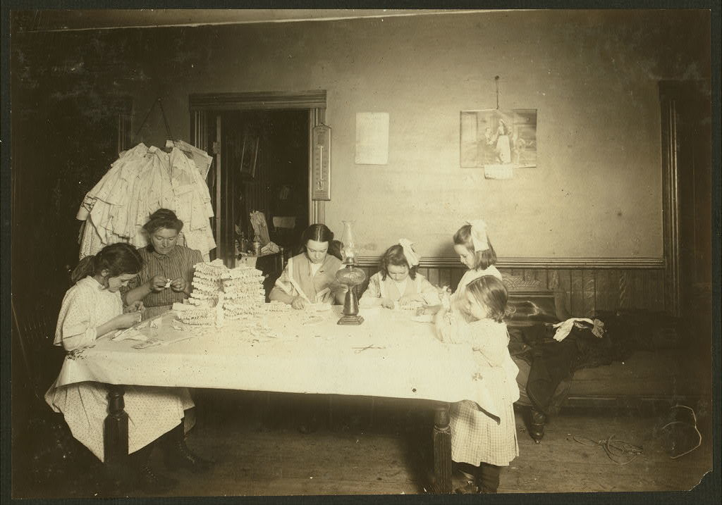 Photo at 4 P.M. Witness F. A. Smith. Home of Thomas Murry, 8 1/2 Milton St., rear, top floor, Worcester, Mass. Mother and children, 6 yrs., 8 yrs. two of 12 yrs. old. The 3-year-old helps a little. Earn $1.50 to $3.00 a week working on hose supporters. Father makes $15 a week. Two other children work: one gets $7 to $11 a week, one gets $4 a week. Home workers work until 8:30 or 9 P.M. nearly every day. (See also Report.)  Location: Worcester, Massachusetts.