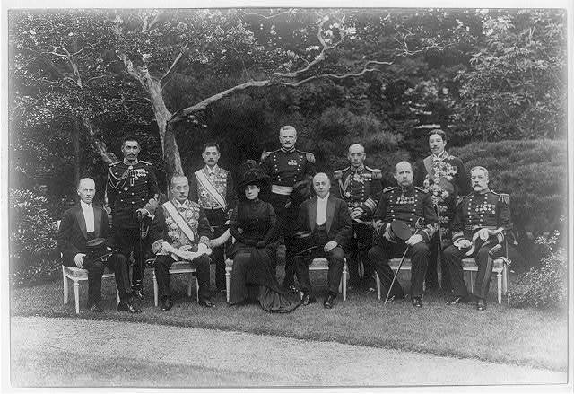 [Secretary of State Philander Chase Knox with his wife, General Pershing and others, posed formally in a garden after the death of Mikado, Japan, Nov. 23, 1912]