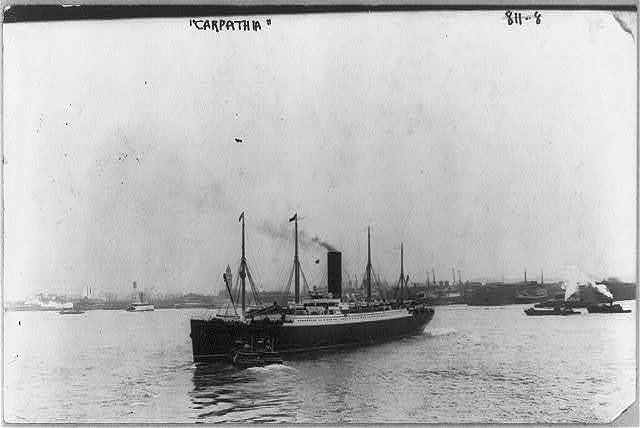 [Steamship CARPATHIA - bow view with 2 tugboats at bow]