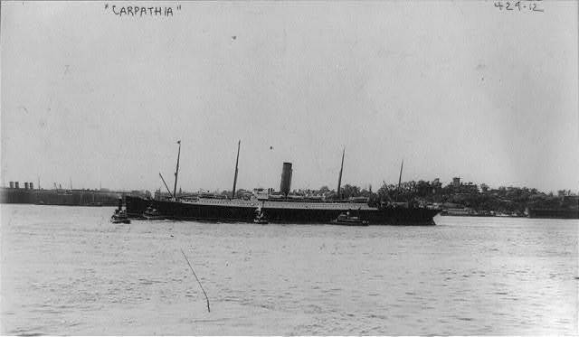 [Steamship CARPATHIA - broadside view, port side, 4 tugboats alongside]