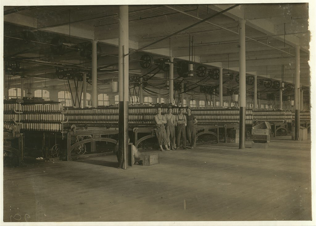 The Mule Room in the New Bedford Cotton Mill. Some small boys are employes in mule rooms.  Location: New Bedford, Massachusetts.