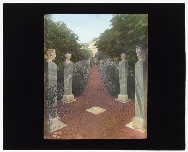 """[""""The Orchard,"""" James Lawrence Breese house, 151 Hill Street, Southampton, New York. Herms along pathway]"""