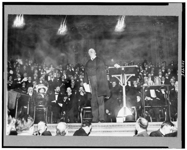 [Theodore Roosevelt, full-length portrait, standing, facing front, speaking at Carnegie Hall]