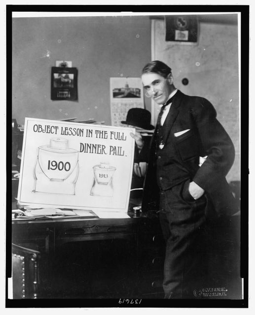 "[Theron Akin, three-quarter length portrait, holding a poster entitled ""Object lesson in the full dinner pail""] / GV. Buck, Wash. D.C."